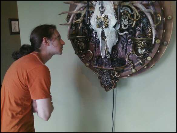 Cody examining an artwork by Michael Thomsen