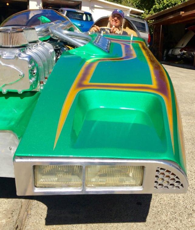 "Donig behind the wheel of his custom Hot Wheels ""Splittin Image"" car from the Gotham Garage."